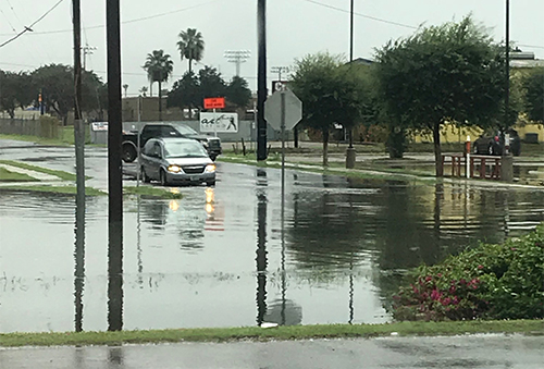 Cars found it difficult to navigate the flooded streets. Photo courtesy of Dante Galeazzi.