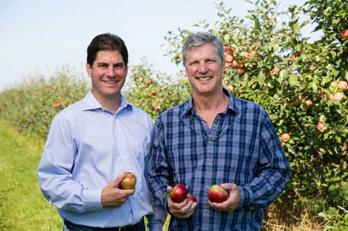 Left to right, Don Roper, Vice President Sales and Marketing, and Fred Wescott, President, in one of Honeybear's many varietal development grower orchards