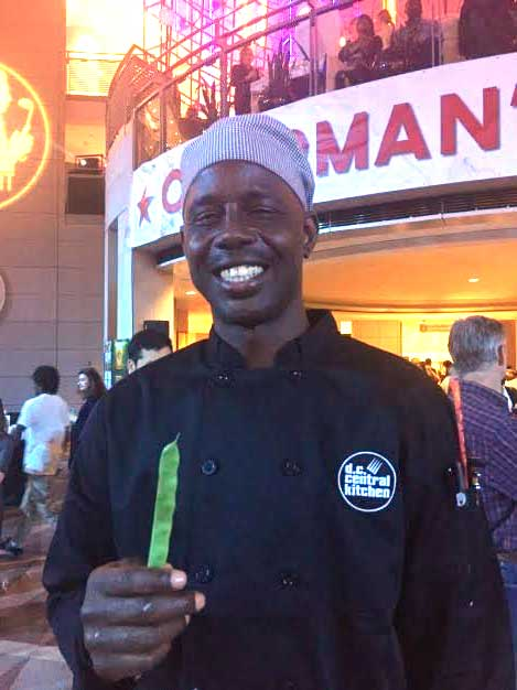 A cook from DC Central Kitchen's culinary training program gives Mann's Tenderbite® Beans some love