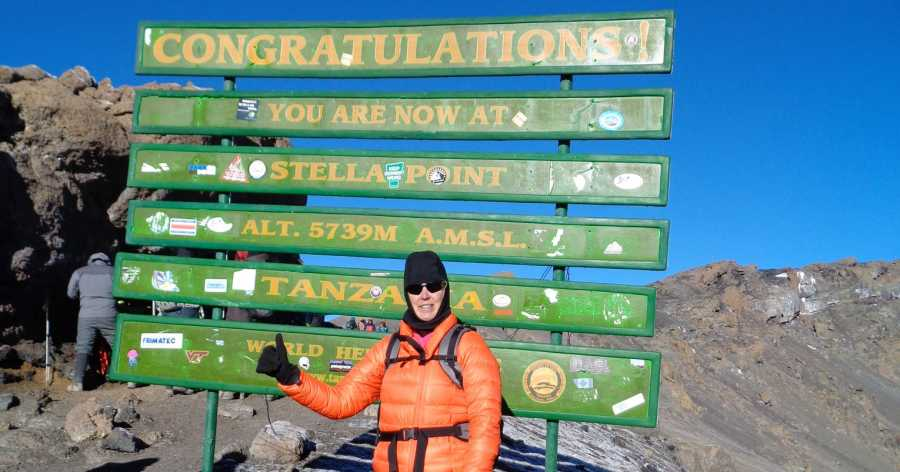 Michele McNeece Summiting Mt. Kilimanjaro
