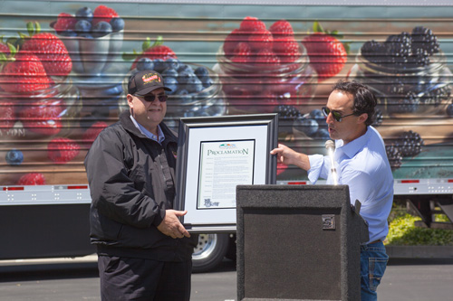 NBG President Rich Amersehhi (left) being presented with a proclamation for Naturipe Farms' 100-Year Anniversary by Tom Nunes (right).