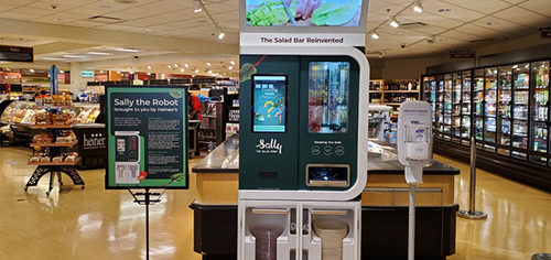 Startup company Chowbotics recently unveiled a robotic solution named Sally for grocers looking to provide the most hygienic custom salad bar experience available on the market (Photo: Heinen's)