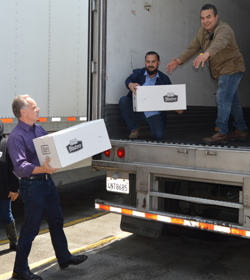 Tony Sarsam and Ready Pac Foods employees loading the donation truck