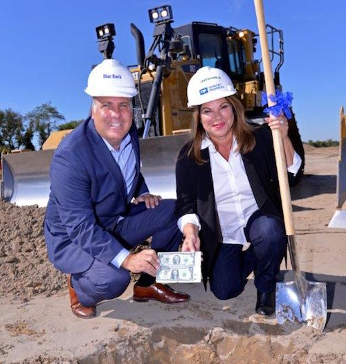 Real Estate Broker David Ricci joins President Mayda Sotomayor-Kirk in burying a $1 and $2 bill for good luck
